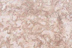 De versleten bleke rode concrete achtergrond van de muurtextuur Geweven pleister royalty-vrije stock foto's
