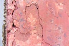 De versleten bleke rode concrete achtergrond van de muurtextuur Geweven pleister stock afbeelding