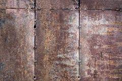 De versleten donkere bruine roestige achtergrond van de metaaltextuur het concept t Royalty-vrije Stock Afbeeldingen