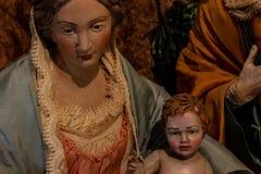 De vertegenwoordiging van de heilige familie, Maagdelijke Mary die het Kind Jesus houden en naast St Joseph royalty-vrije stock afbeeldingen