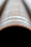De verticale samenvatting van de staalpijp stock foto