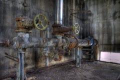 De verwarmer leidt oude textilfabriek door buizen Royalty-vrije Stock Foto's