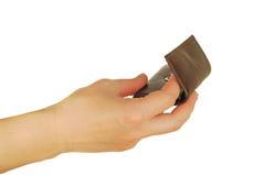 De verwijfde hand houdt een beurs Stock Foto's