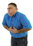 De vette mens met maagpijnen, werpt Stock Foto's