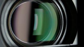 De videocameralens, die gezoem tonen, sluit omhoog stock footage