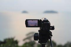 De videocamerawerken op de verslagwijze Stock Foto's