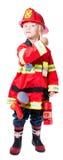 De vier éénjarigenjongen kleedde zich aangezien een brandweerman aantoont dat allen goed is Stock Foto's