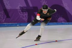 De vijf keer Olympische Kampioen Claudia Pechstein van Duitsland concurreert in de Dames` 5,000m Snelheid Schaatsend bij 2018 de  stock afbeelding