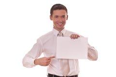 De vinger van de mens hows op leeg document Stock Afbeeldingen