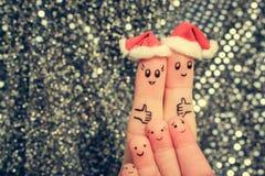 De vingerkunst van grote familie viert Kerstmis Stock Foto's