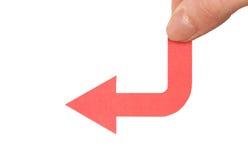 De vingers die van vrouwen pijl houden Stock Fotografie