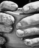 De vingers van de Pottenbakker Stock Foto's