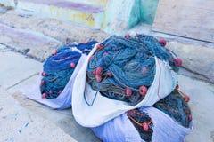 De visnetten voor Overzees worden opgerold sloegen Gekleurde Muur die royalty-vrije stock foto