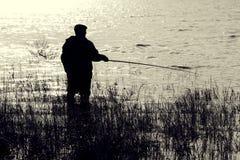 De visser met een staaf royalty-vrije stock afbeeldingen