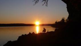De visser van de zonsondergang Stock Afbeeldingen