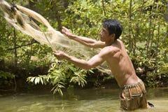 De visserij met werpt netto stock afbeeldingen