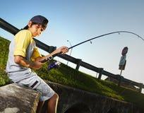De visserij van de jongen Stock Foto's