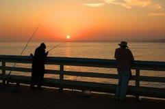 De Visserij van de zonsondergang Stock Foto's