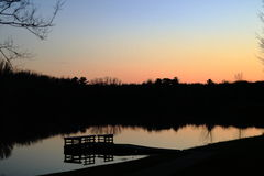 De visserij van dok bij zonsondergang stock foto