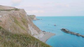 De vita klipporna av England på solnedgången arkivfilmer