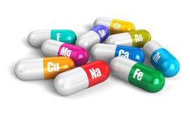 De vitaminepillen van de kleur Stock Fotografie