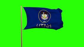 De vlag die van Utah met titel in de wind golven looping stock footage