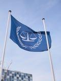 De vlag en de nieuwe Internationale Strafrechter Stock Afbeeldingen