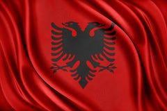 De Vlag van Albanië Vlag met een glanzende zijdetextuur Stock Foto