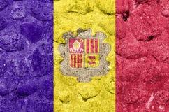 De Vlag van Andorra op een steenmuur stock illustratie
