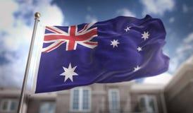 De Vlag van Australië het 3D Teruggeven op Blauwe Hemel de Bouwachtergrond Royalty-vrije Stock Afbeelding