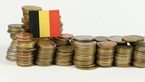 De vlag van België met stapel geldmuntstukken stock footage