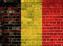 De vlag van België op een bakstenen muur royalty-vrije stock fotografie