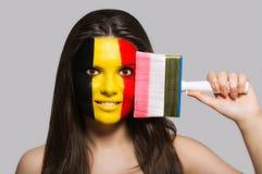 De vlag van België op het gezicht wordt geschilderd dat royalty-vrije stock afbeelding