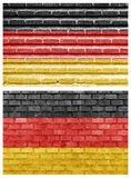 De vlag van Duitsland op verschillende bakstenen muren Stock Foto