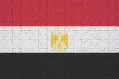De vlag van Egypte wordt afgeschilderd op een gevouwen raadsel vector illustratie