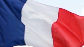 De vlag van de golven van Frankrijk in de wind in langzame motie stock footage