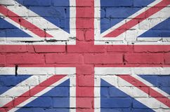 De vlag van Groot-Brittannië is geschilderd op een oude bakstenen muur royalty-vrije stock afbeelding