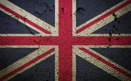 De vlag van Groot-Brittannië op de oude achtergrond van de grungemuur Stock Foto's