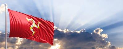 De vlag van het Eiland Man op blauwe hemel 3D Illustratie Stock Afbeeldingen