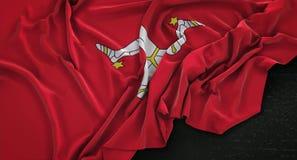 De Vlag van het Eiland Man op Donkere 3D die Achtergrond wordt gerimpeld geeft terug Stock Foto's