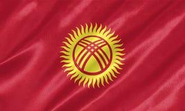 De vlag van Kyrgyzstan stock afbeelding