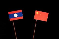 De vlag van Laos met Chinese vlag op zwarte stock afbeeldingen