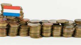 De vlag van Luxemburg met stapel geldmuntstukken stock footage