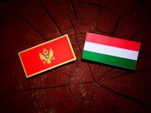 De vlag van Montenegro met Hongaarse vlag op een geïsoleerde boomstomp stock illustratie