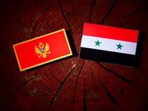 De vlag van Montenegro met Syrische vlag op een geïsoleerde boomstomp vector illustratie
