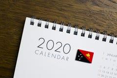 De Vlag van Papoea-Nieuw-Guinea op de Kalender van 2020 royalty-vrije stock afbeelding