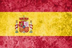 De Vlag van Spanje op de achtergrond van de steentextuur Stock Foto's
