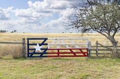 De Vlag van Texas die op de Poort van het Vee wordt geschilderd