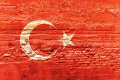 De vlag van Turkije op een bakstenen muur wordt geschilderd die 3D Illustratie Stock Afbeeldingen