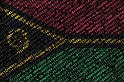 De vlag van Vanuatu wordt afgeschilderd op het scherm met de programmacode Het concept moderne technologie en plaatsontwikkeling royalty-vrije stock foto